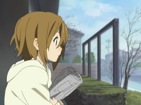 Who's this? Oh wait, that's just Yui drawn differently... why's a log? I mean, newspaper. Must be for firewood.
